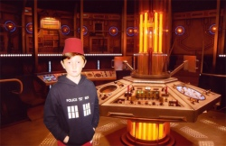 Tom in the Twefth Doctor's TARDIS wearing a Fez.