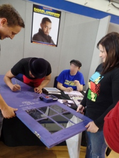 Samuel Anderson signs Luke's TARDIS door