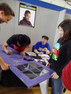 Samuel Anderson signs Luke's TARDIS door