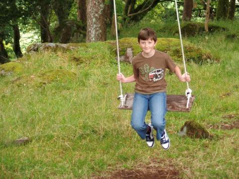 Tom on the swing at Plas Brondanw